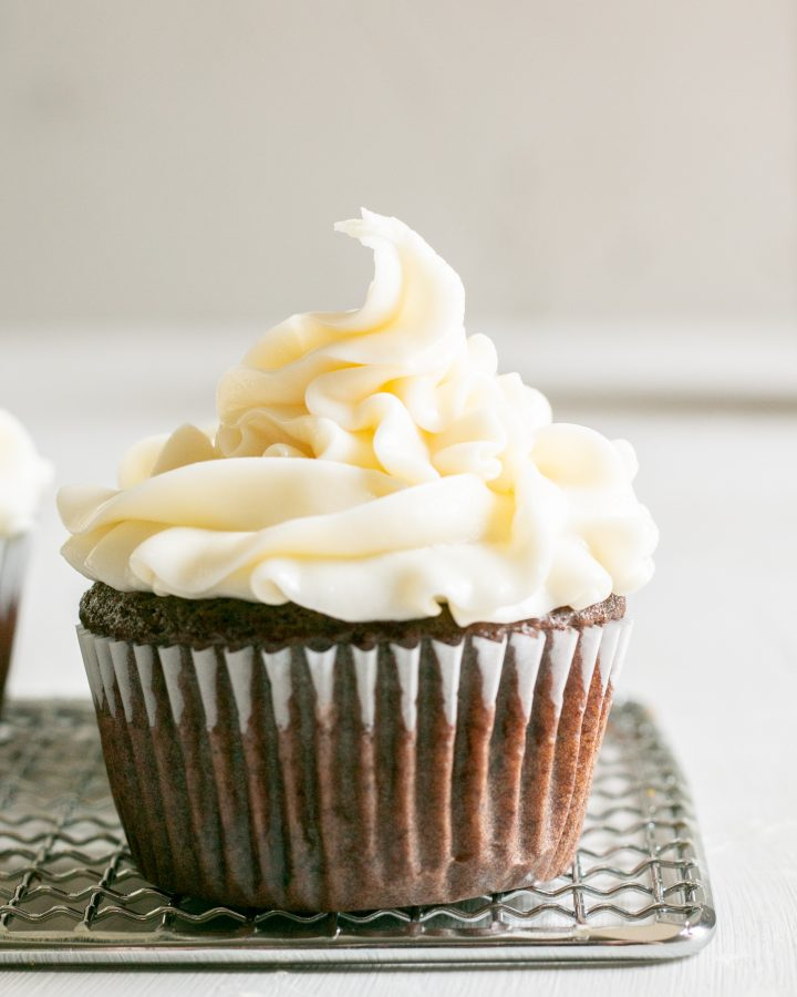 chocolate cupcake with cream cheese buttercream piped on it